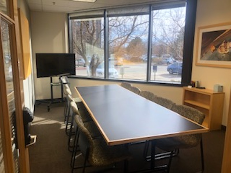 Large Conference Room with TV Monitor and Whiteboard